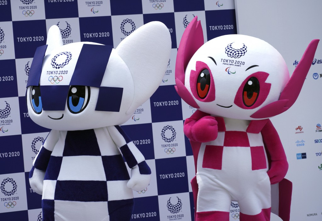 """Tokyo 2020 Olympic mascot """"Miraitowa"""", left, and Paralympic mascot """"Someity"""", right, attend their debut event in Tokyo Sunday, July 22, 2018. The offi"""