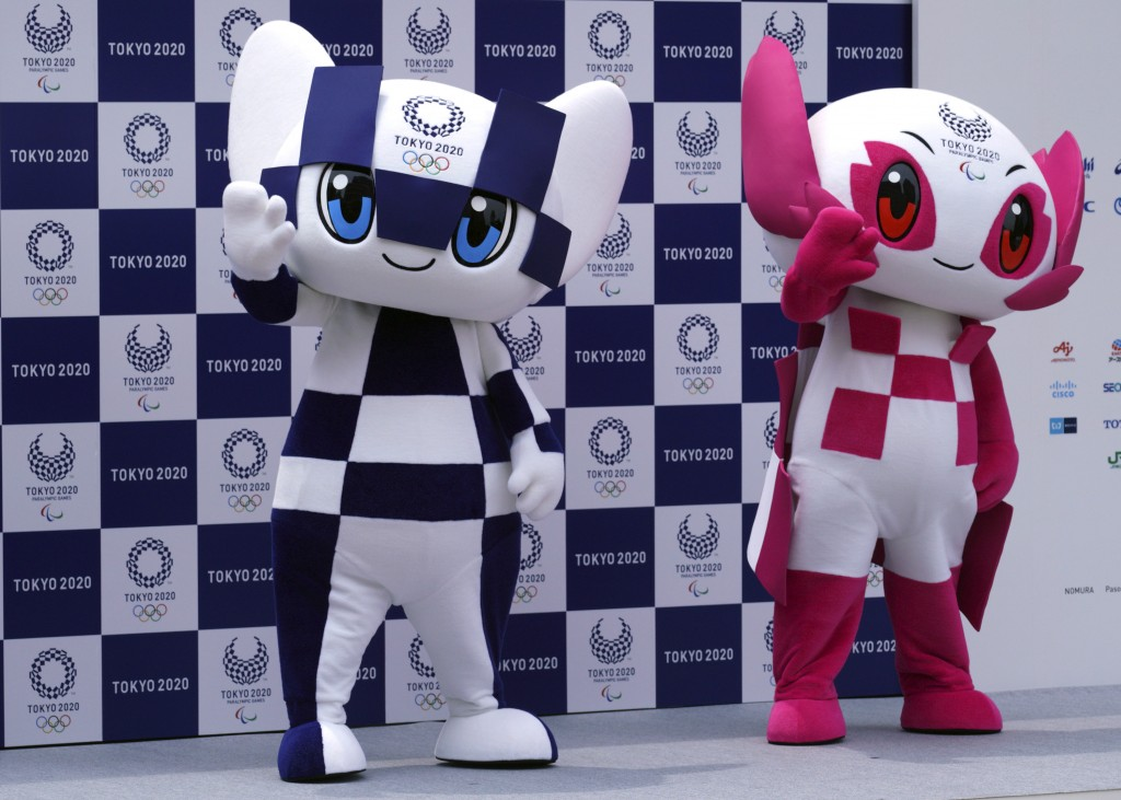"""Tokyo 2020 Olympic mascot """"Miraitowa"""", left, and Paralympic mascot """"Someity"""", right, pose for photographers during the mascot debut event in Tokyo Sun..."""