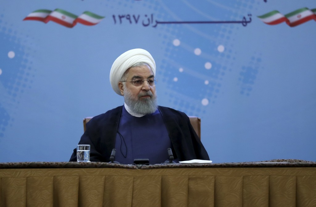 In this photo released by official website of the office of the Iranian Presidency, President Hassan Rouhani attends a meeting with a group of foreign...