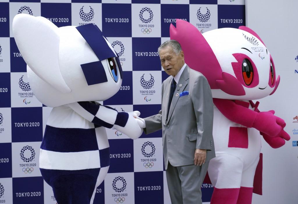 """Tokyo 2020 Olympic mascot """"Miraitowa"""", left, and Paralympic mascot """"Someity"""", right, and Tokyo Olympic organizing committee President Yoshiro Mori, at..."""