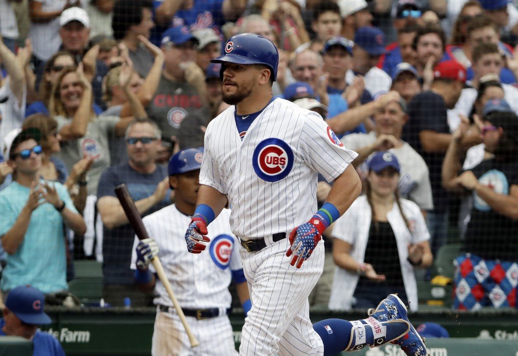 Chicago Cubs' Kyle Schwarber rounds the bases after hitting a solo home run during the sixth inning of a baseball game against the St. Louis Cardinals...