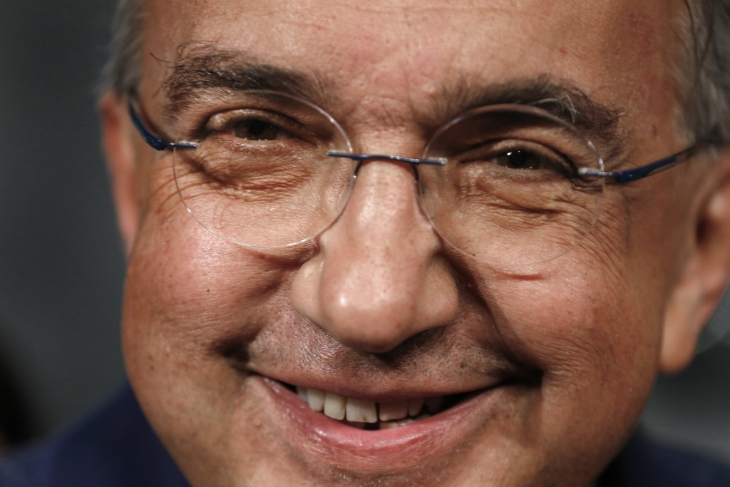 FILE - In this July 14, 2015 file photo, Fiat Chrysler Automobiles CEO Sergio Marchionne smiles during a ceremony to mark the opening of contract nego...
