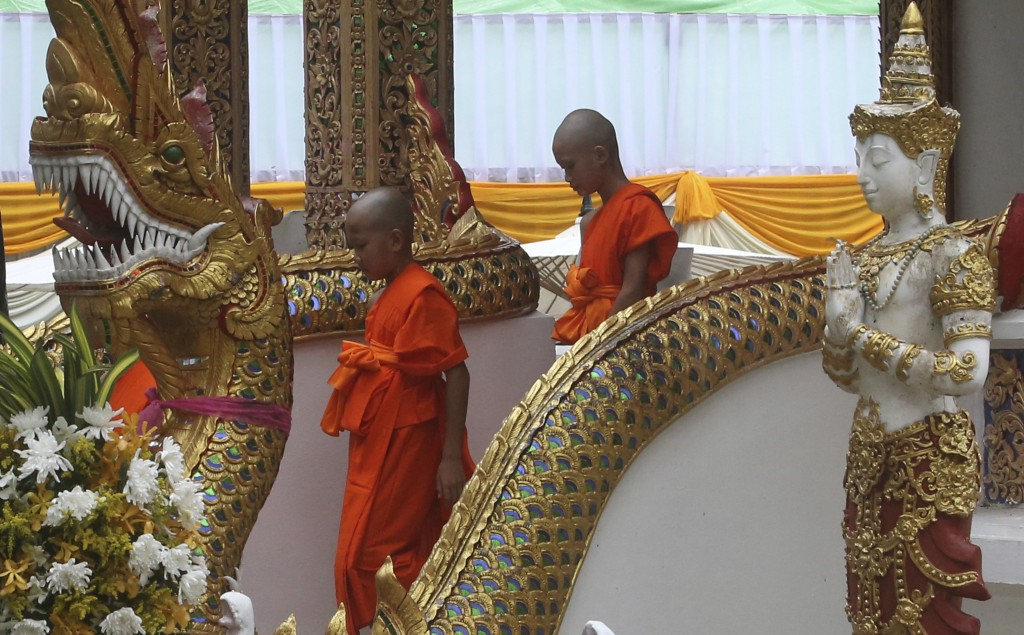 Soccer teammates Chanin Vibulrungruang, left, and Mongkol Boonpiam, who were rescued last week from a flooded cave are ordained as Buddhist monks and ...