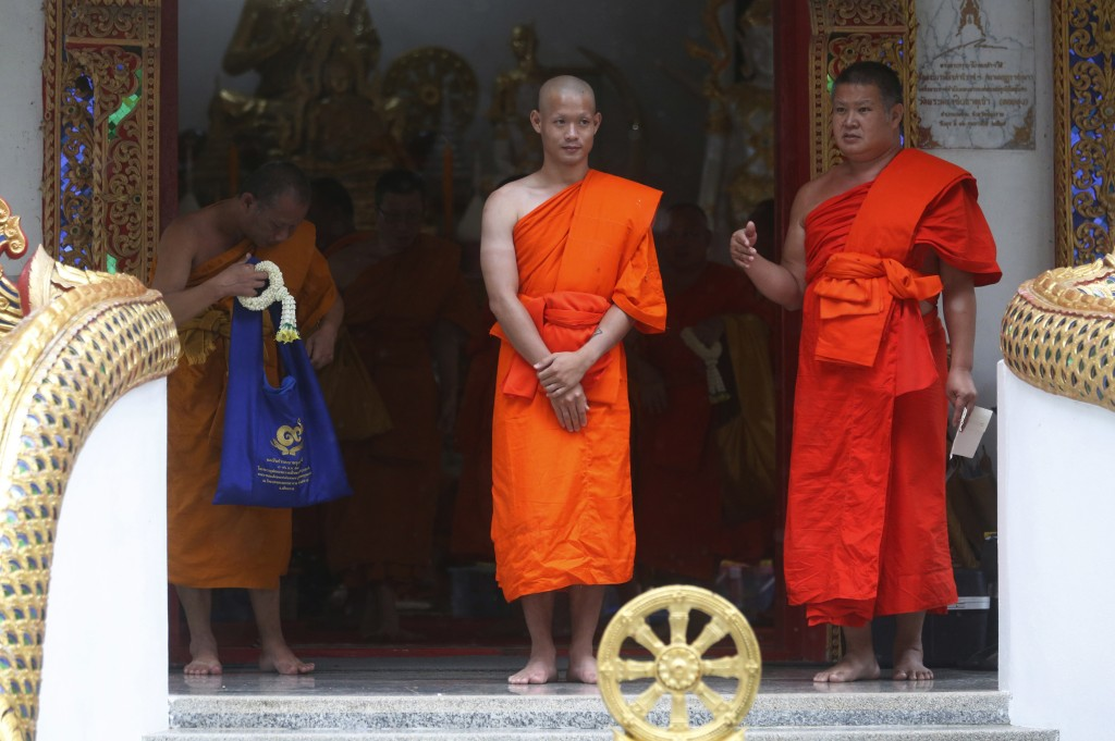 Soccer coach Ekkapol Chanthawong, center, who was rescued from a flooded cave, attends a Buddhist ceremony as he was ordained as Buddhist monk in the ...