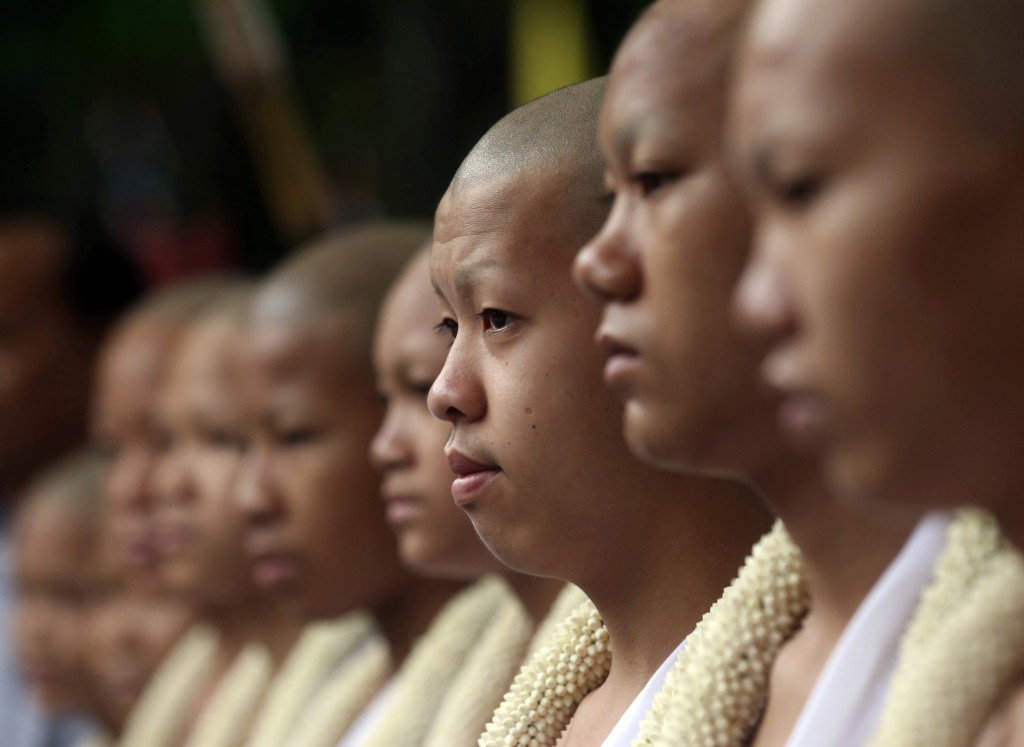 Members of the soccer team who were rescued from a flooded cave, attend a Buddhist ceremony as they prepare to be ordained as Buddhist monks and novic...