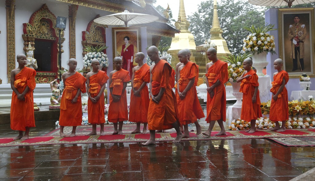 The young soccer teammates and their coach who were rescued from a flooded cave, attend a Buddhist ceremony as they prepare to be ordained as Buddhist...