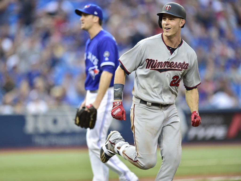 Minnesota Twins' Max Kepler heads to first after being hit by a pitch with the bases loaded, driving in Brian Dozier with the go-ahead run, as Toronto...