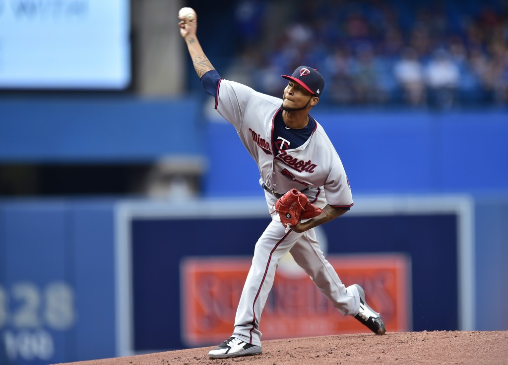Minnesota Twins starting pitcher Ervin Santana works during the first inning of a baseball game against the Toronto Blue Jays, Wednesday, July 25, 201...