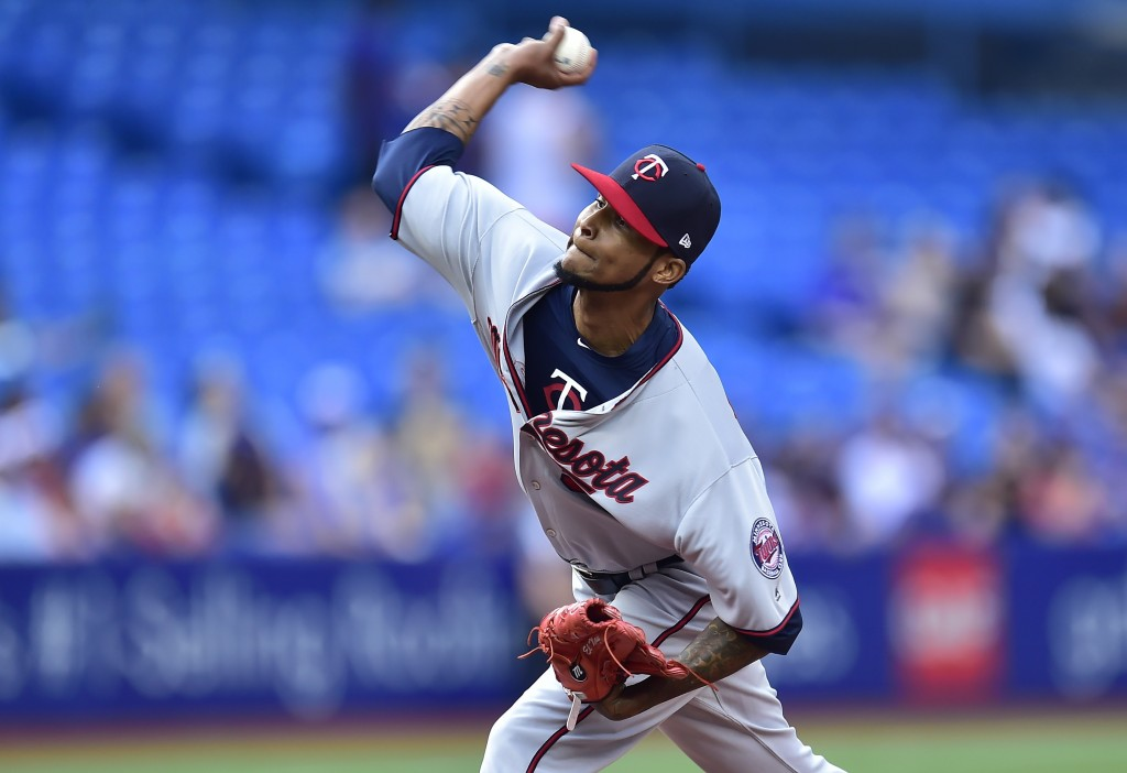 Minnesota Twins starting pitcher Ervin Santana (54) works during the first inning of a baseball game against the Toronto Blue Jays, Wednesday, July 25...