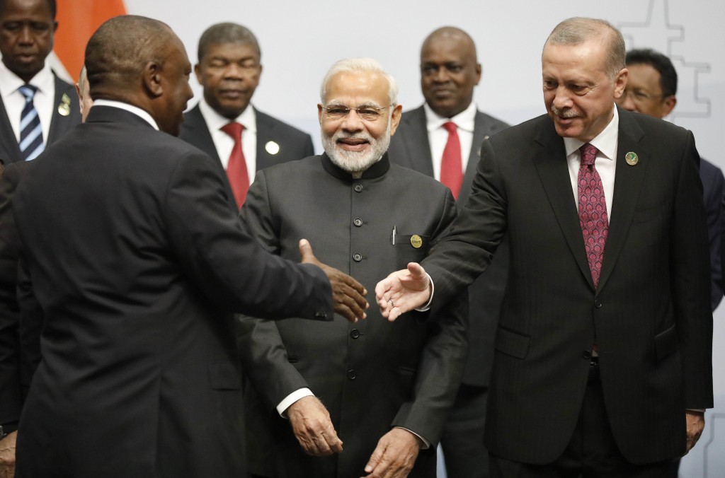 Turkey's President Tayyip Erdogan, right, and Indian Prime Minister Narendra Modi, centre, are greeted by South Africa's President Cyril Ramaphosa, le