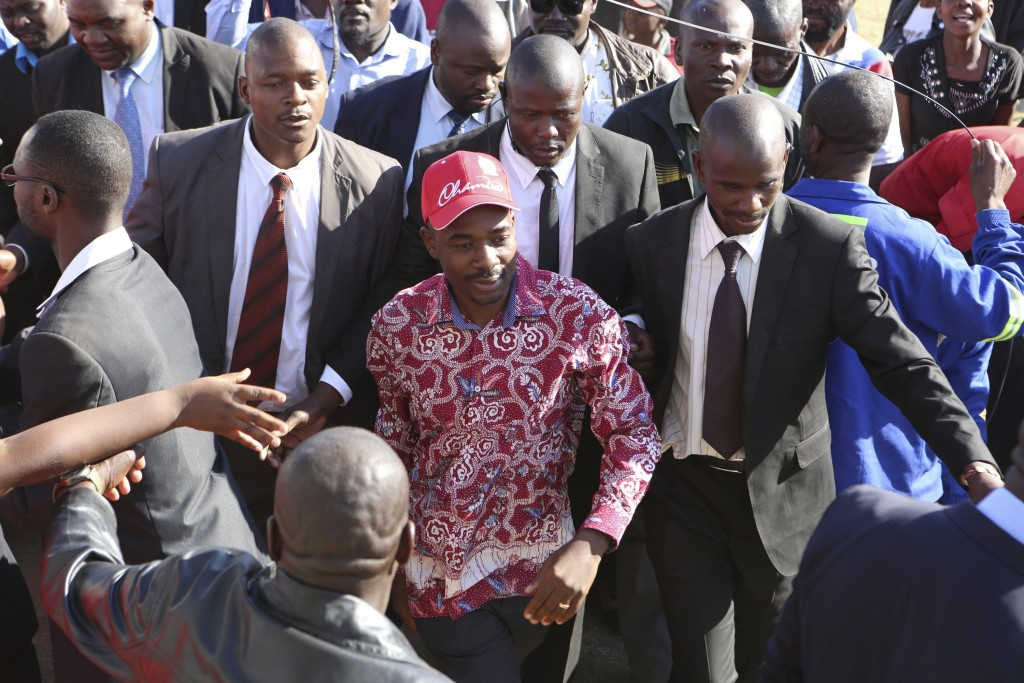 Nelson Chamisa center head of the MDC opposition alliance arrives for a rally in Chitungwiza about 30 kilometres east of the capital Harare Thursda
