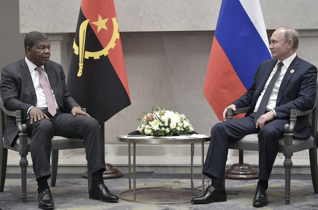 Angola's President Joao Lourenco, left, speaks to Russia's President Vladimir Putin at the BRICS summit in Johannesburg, South Africa, Thursday, July