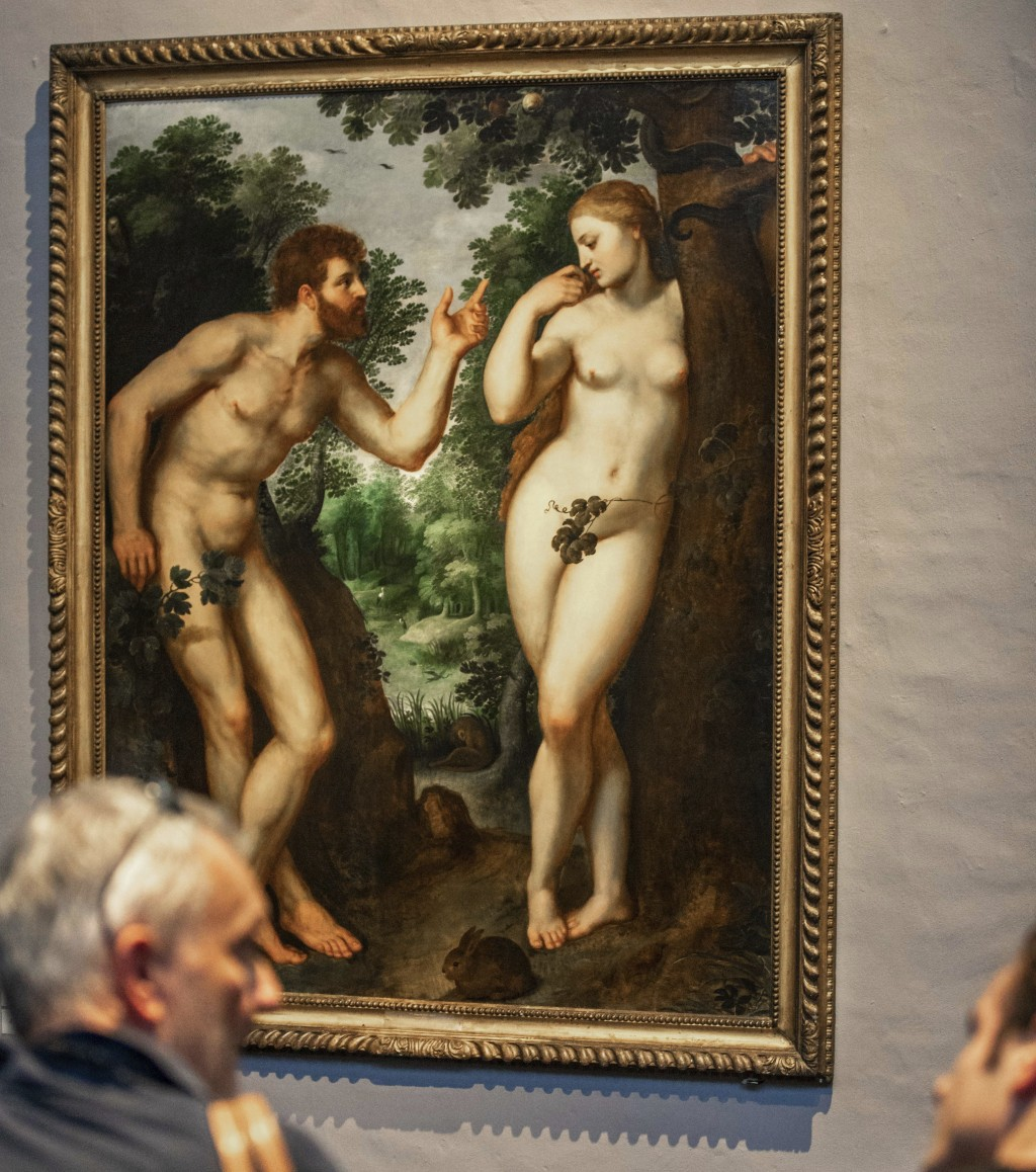 "In this photo taken on Thursday, July 26, 2018, visitors look at the painting ""Adam and Eve"" by Flemish master Peter Paul Rubens in the Rubenshouse in"
