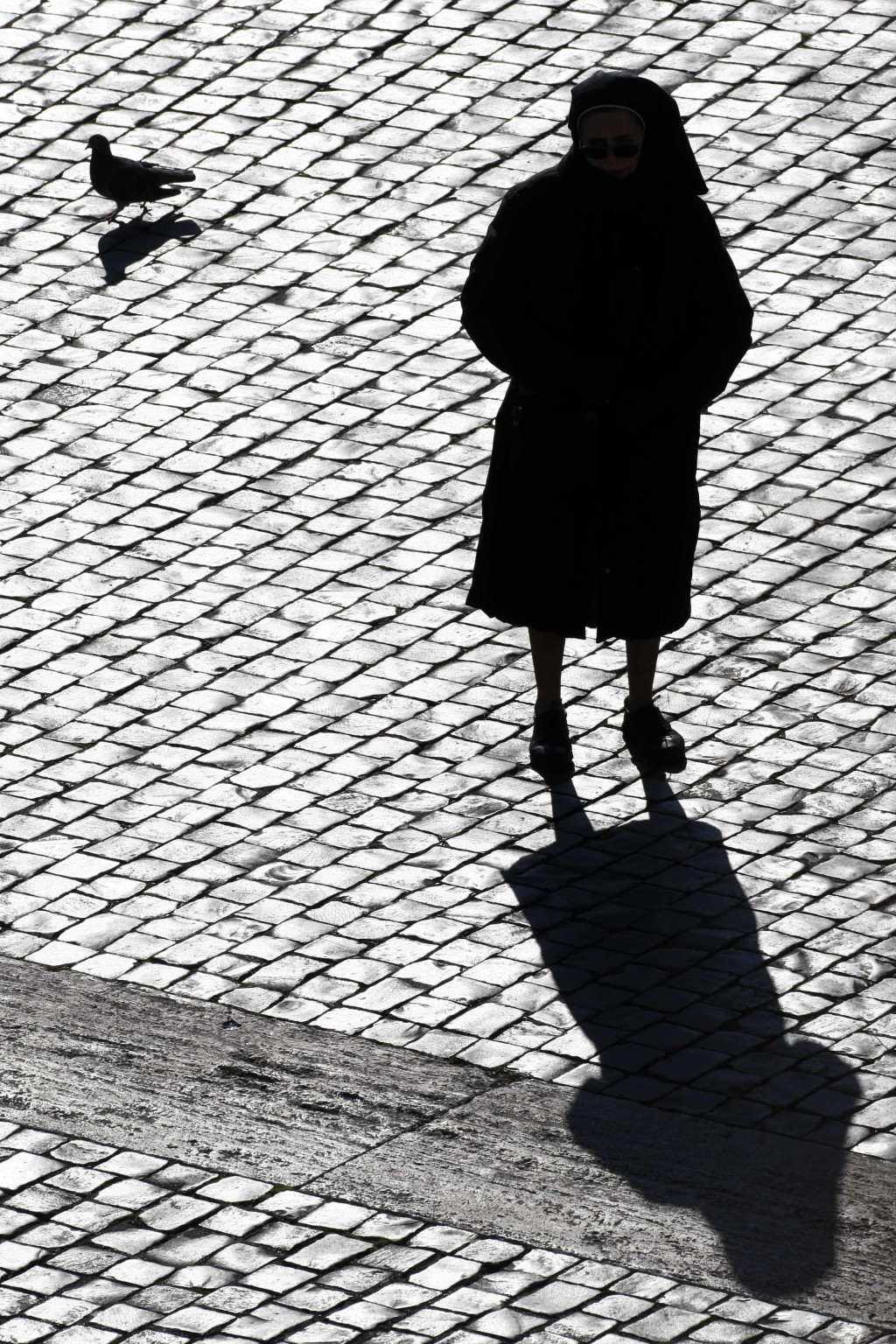 FILE - In this Sunday, Dec. 20, 2009 file photo, a nun is silhouetted in St. Peter's Square at the Vatican. Some nuns are now finding their voices, bu...