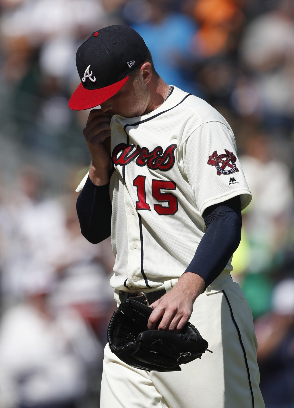 Atlanta Braves starting pitcher Sean Newcomb (15) walks off the field after losing a no-hitter in the ninth inning of a baseball game against the Los ...