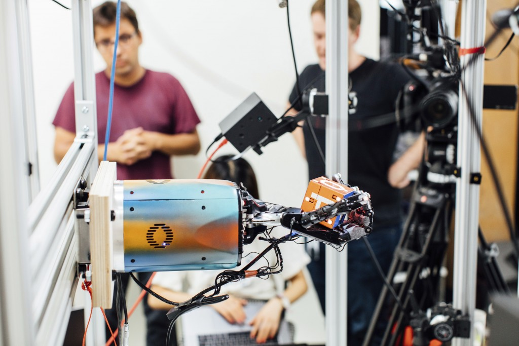 This undated photo provided by OpenAI shows a robotic hand rotating a cube at the company's research lab in San Francisco. The hand, called Dactyl, ha...