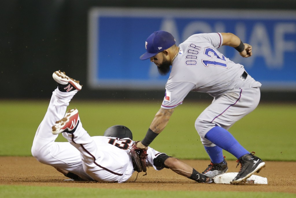 Arizona Diamondbacks Nick Ahmed dives back into second base safely under the tag of Texas Rangers second baseman Rougned Odor in the fourth inning dur...