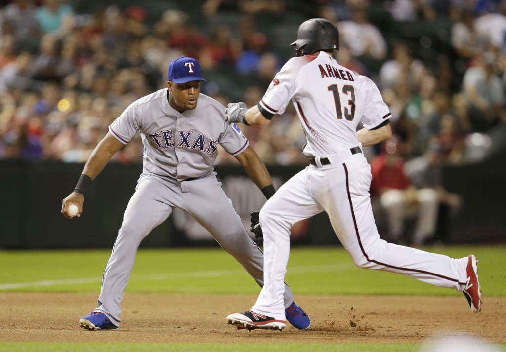 Texas Rangers third baseman Adrian Beltre tags out Arizona Diamondbacks Nick Ahmed (13) on a fielder's choice hit by Robbie Ray in the fourth inning d...