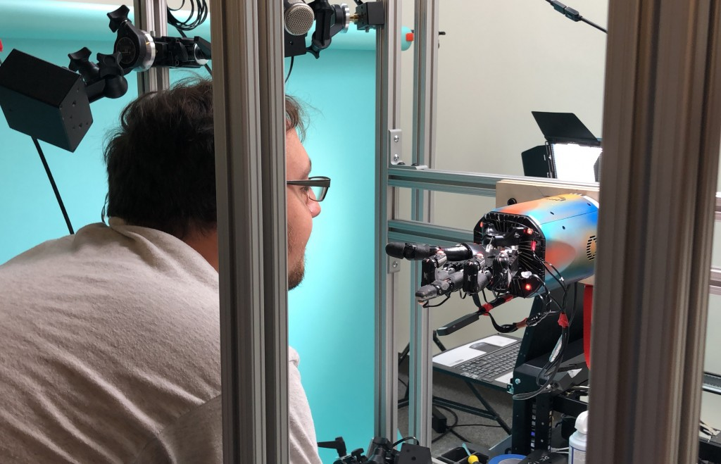 In this Thursday, July 26, 2018, photo, OpenAI researcher Jonas Schneider examines the research lab's robotic hand in San Francisco. The hand, called ...