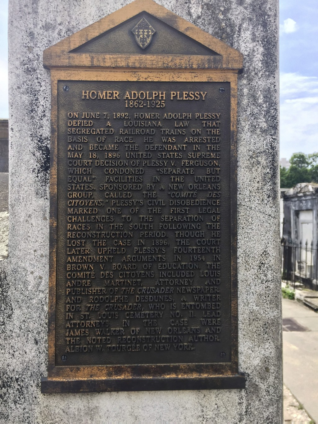This June 3, 2018 photo shows a marker on the burial site for Homer Plessy at St. Louis No. 1 Cemetery in New Orleans. Plessy was an important figure ...