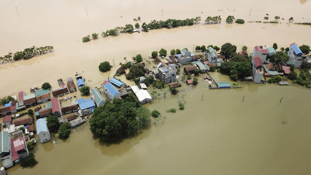 An aerial view of flooded village in Chuong My district, Hanoi, Vietnam on Tuesday, July 31, 2018. High seasonal floods have killed three people and t...