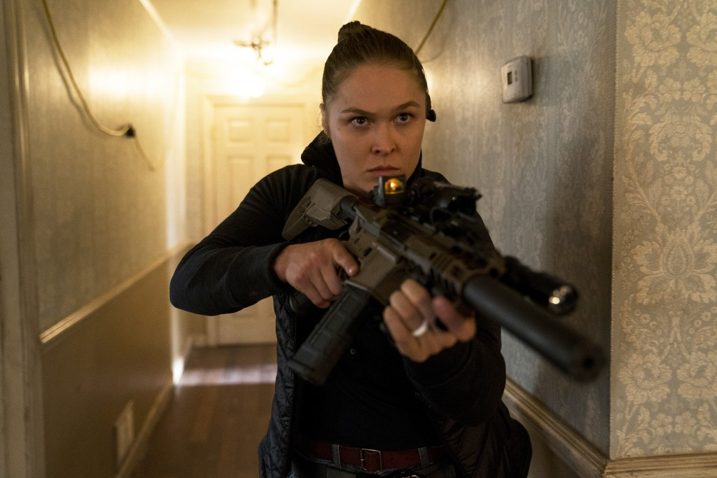 """This cover image released by STXfilms shows Ronda Rousey in a scene from """"Mile 22."""" (STXfilms via AP)"""