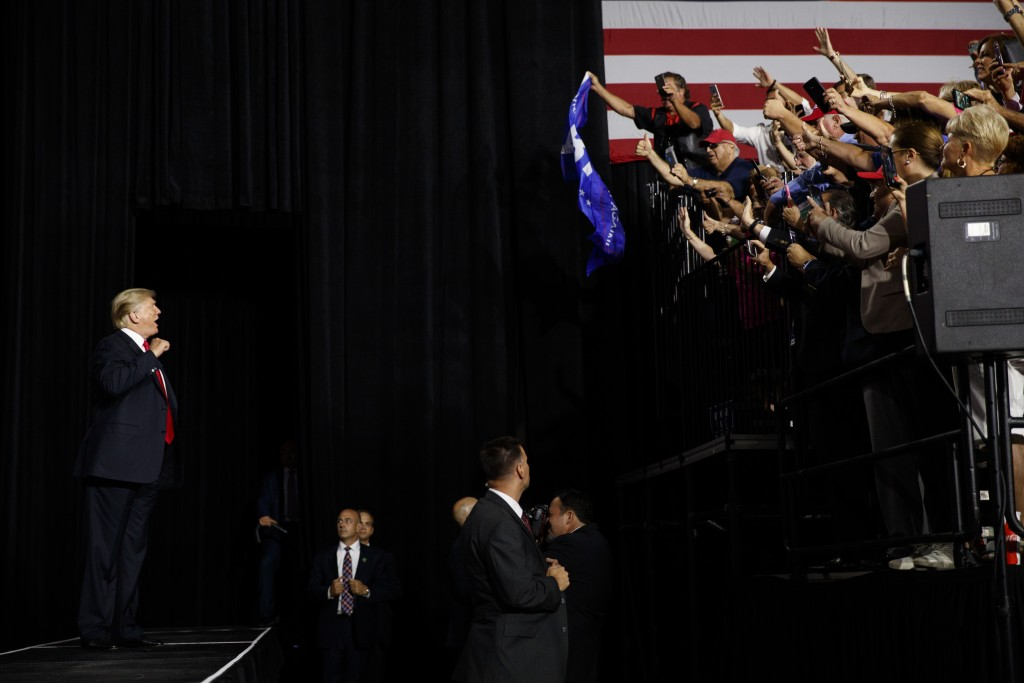 President Donald Trump arrives at a rally at Florida State Fairgrounds Expo Hall, Tuesday, July 31, 2018, in Tampa, Fla. (AP Photo/Evan Vucci)