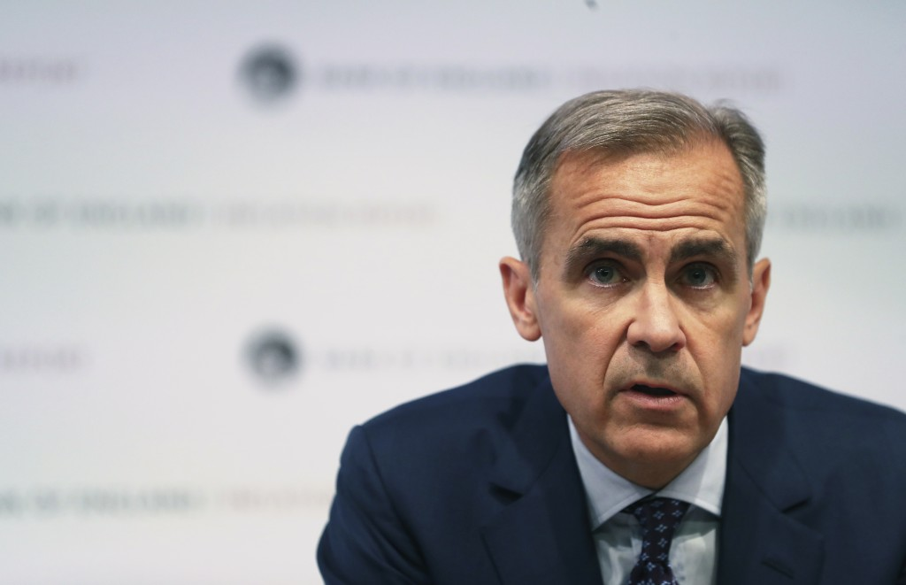 Bank of England Governor Mark Carney speaks during a media conference to present the central bank's quarterly Inflation Report in London Thursday
