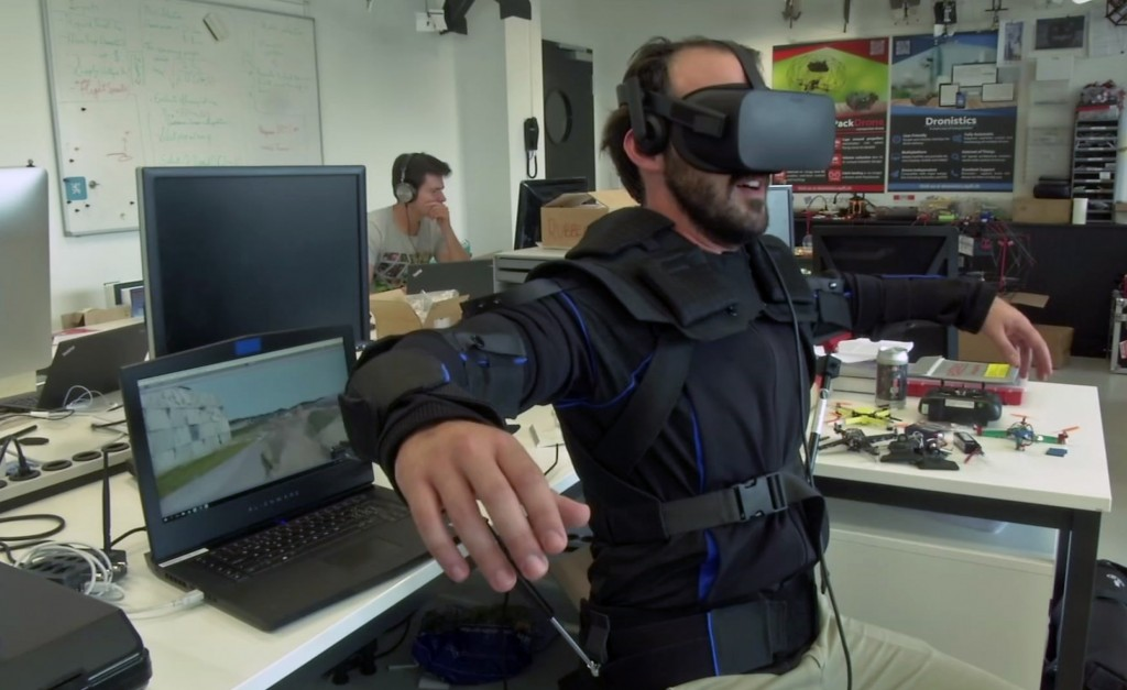 Robotics expert on the Ecole Polytechnique Federal de Lausanne, EPFL team, Matteo Macchini, displays the fly controls in a virtual reality scenario as...
