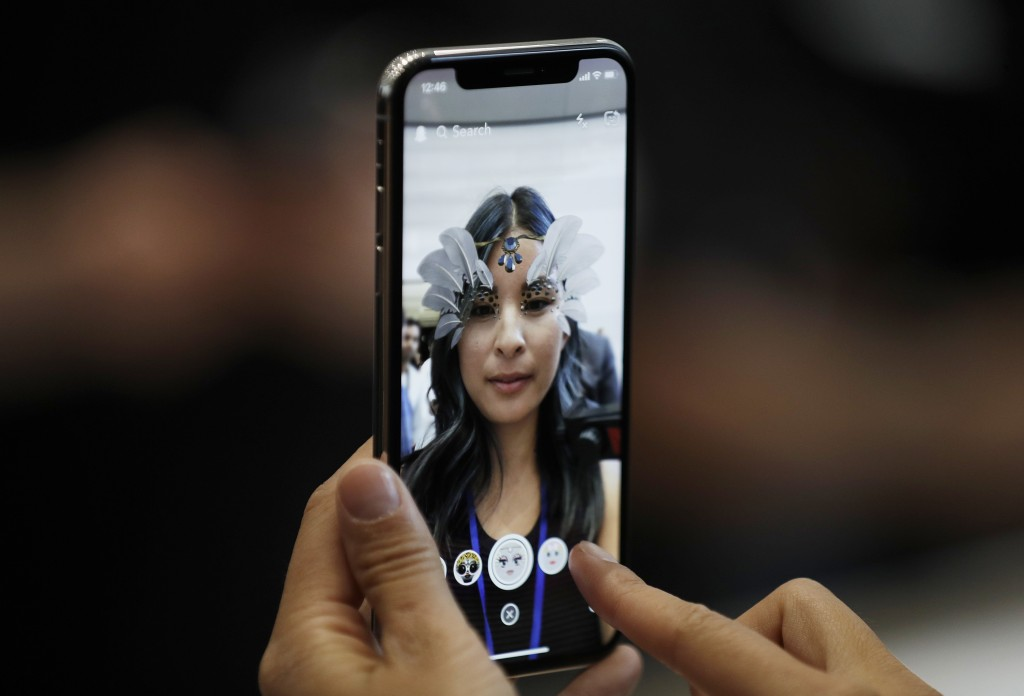 FILE -In this  Sept. 12, 2017, photo, the new iPhone X is displayed in the showroom after the new product announcement in Cupertino, Calif.  Apple has...