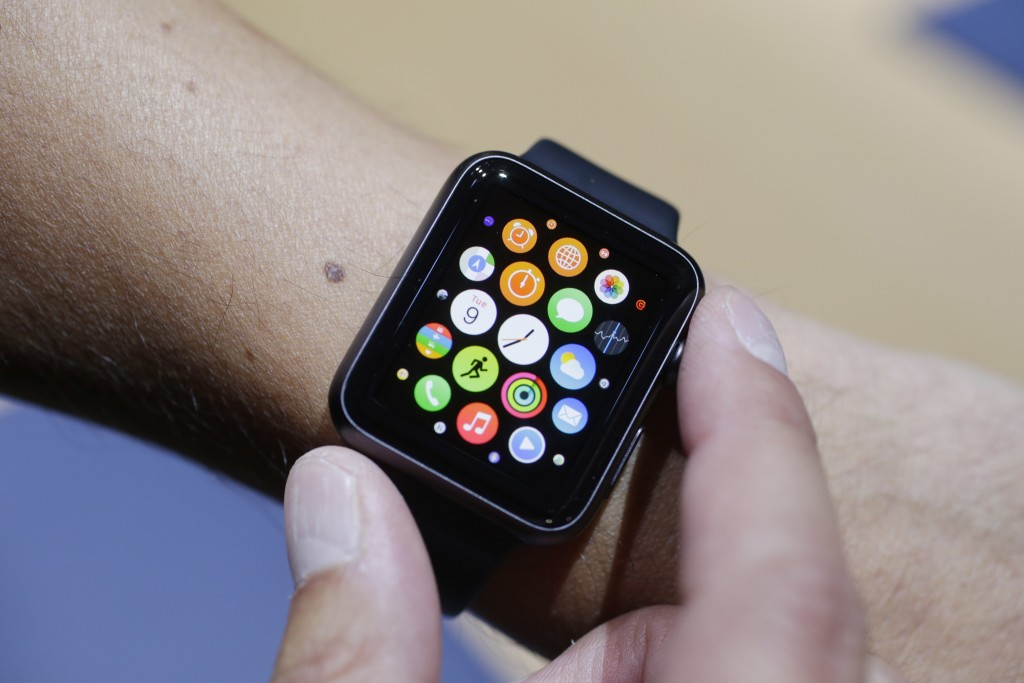 FILE - In this Sept. 9, 2014 file photo, the new Apple Watch is modeled during a media event in Cupertino, Calif.  Apple has become the world's first ...