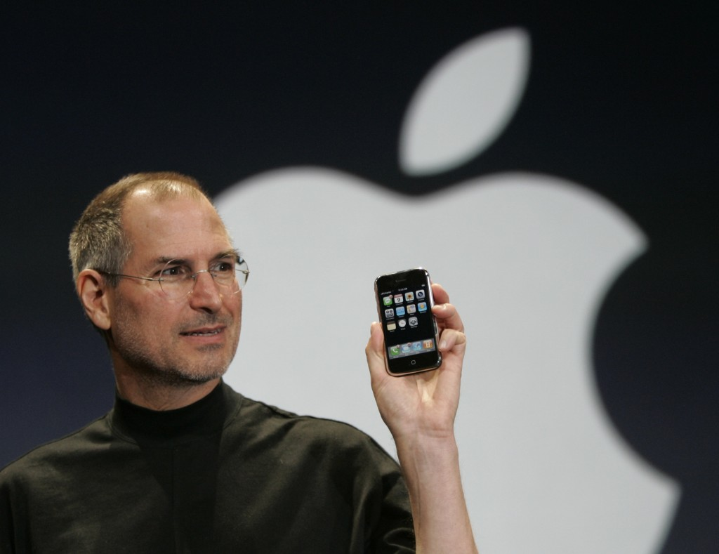 FILE - In this Jan. 9, 2007 file photo, Apple CEO Steve Jobs holds up the new iPhone during his keynote address at MacWorld Conference & Expo in San F...