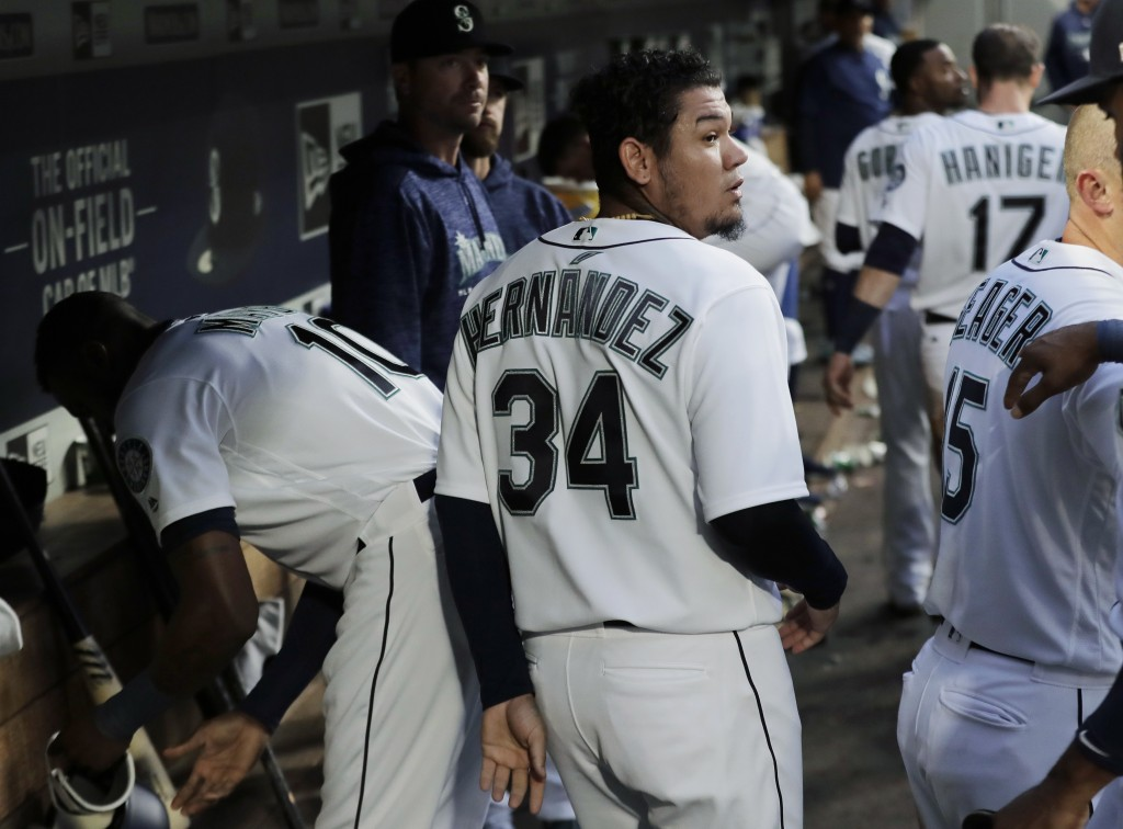 Seattle Mariners starting pitcher Felix Hernandez (34) walks in the dugout after the fourth inning of a baseball game against the Toronto Blue Jays, T