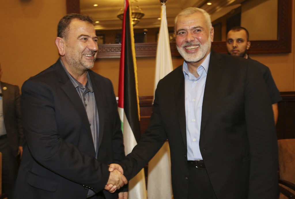 Hamas Media Office Ismail Haniyeh right the head of the Hamas political bureau shakes hands with his deputy Saleh Ar