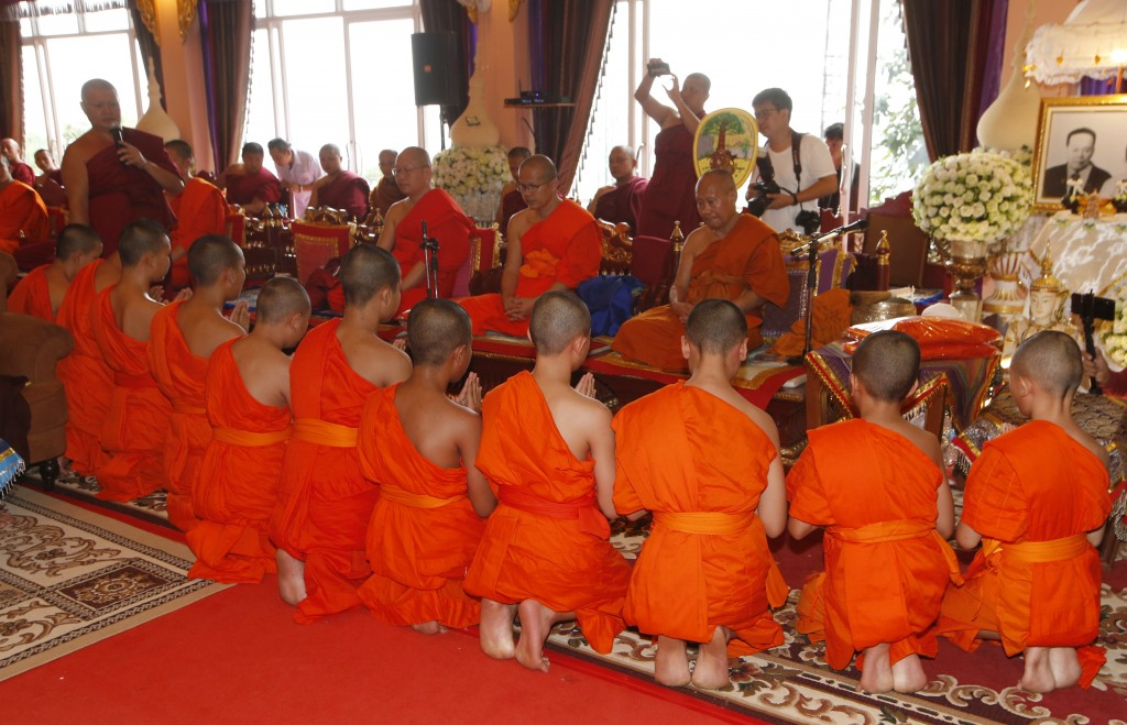 Members of Wild Boars soccer team pray during a ceremony marking the completion of serving as a novice Buddhist monks following their dramatic rescue ...