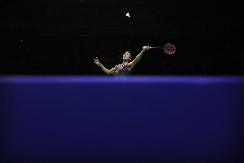 In this Saturday, Aug. 4, 2018, file photo, Kento Momota of Japan plays a shot while competing against Daren Liew of Malaysia in their men's badminton