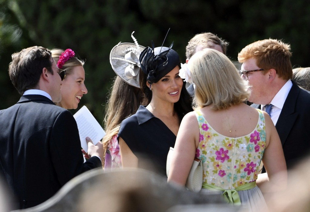 Meghan Duchess of Sussex arrives to attend the wedding of Charlie van Straubenzee and Daisy Jenks at St Mary the Virgin Church in Frensham England