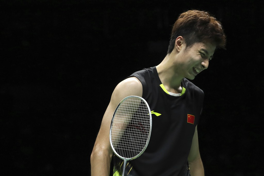 Shi Yuqi of China reacts while competing against Kento Momota of Japan in their men's badminton championship match at the BWF World Championships in N...