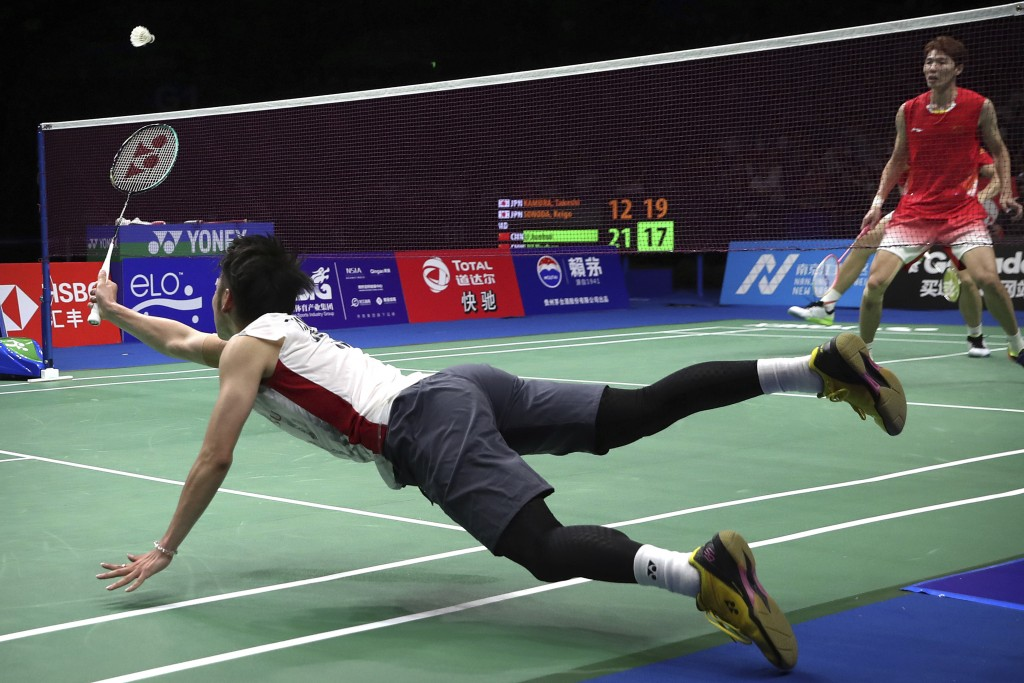 Takeshi Kamura of Japan plays a shot while competing with his partner Keigo Sonoda against Li Junhui and Liu Yuchen of China in their men's doubles ba...