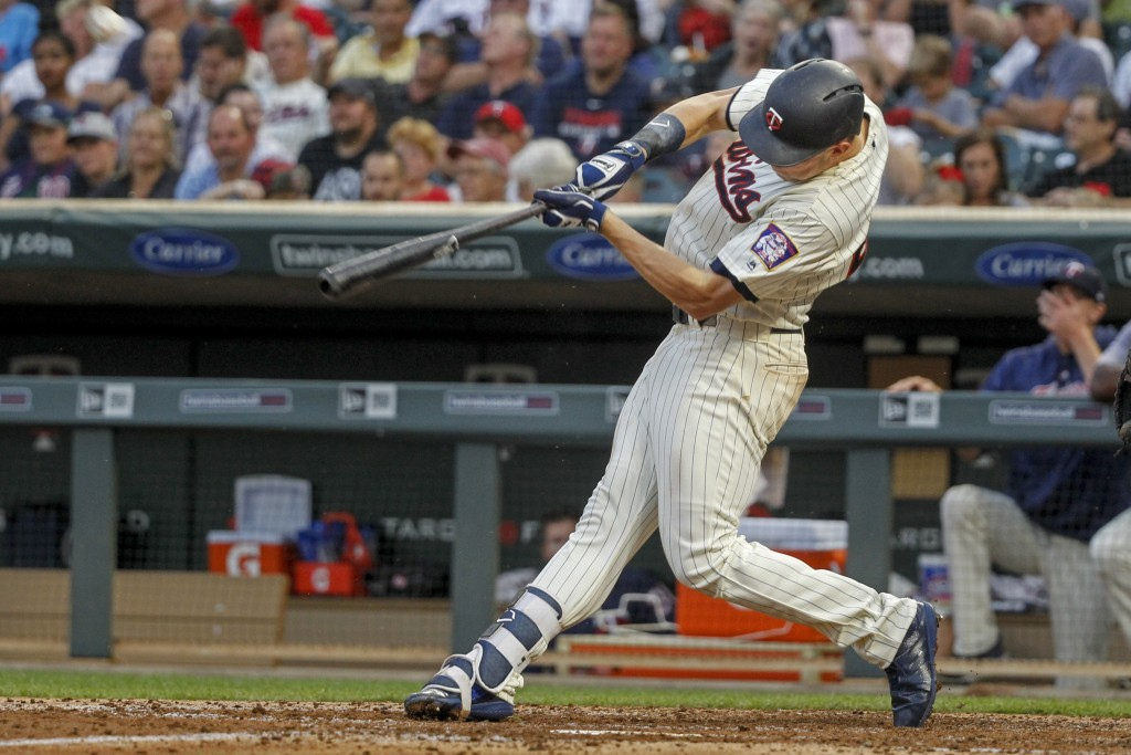 Minnesota Twins Max Kepler hits a two-run homer against the Kansas City Royals in the fourth inning of a baseball game Saturday, Aug. 4, 2018, in Minn...