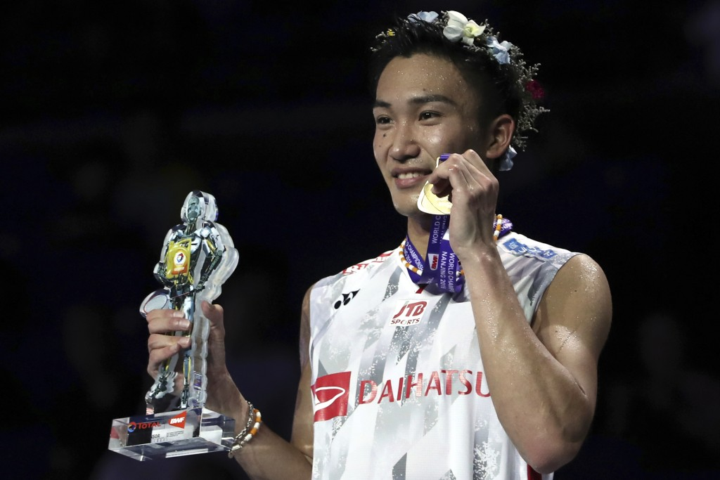 Kento Momota of Japan stands with his medal after beating Shi Yuqi of China in their men's badminton championship match at the BWF World Championships...