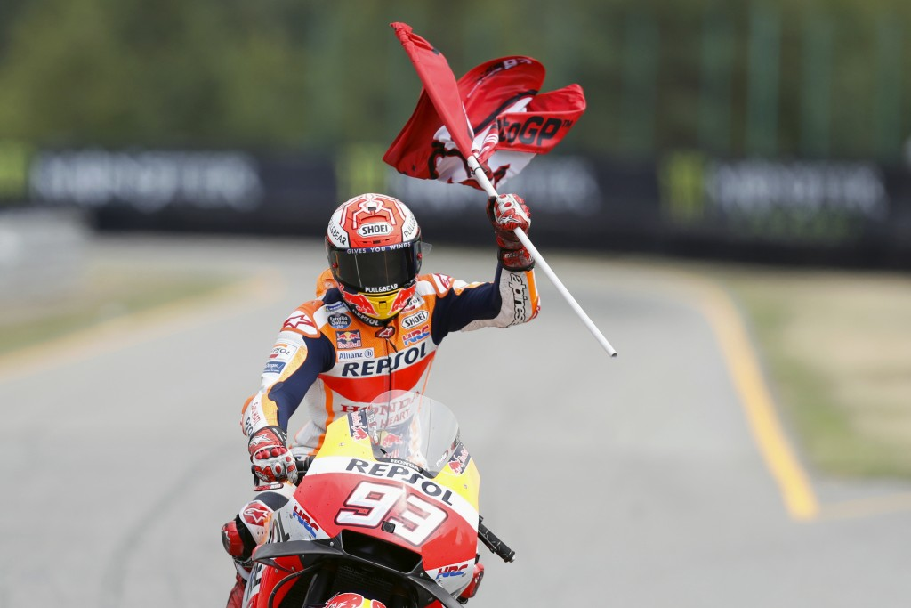 Third placed Spain's rider Marc Marquez of the Repsol Honda Team celebrates after the MotoGP race at the Czech Republic motorcycle Grand Prix at the A