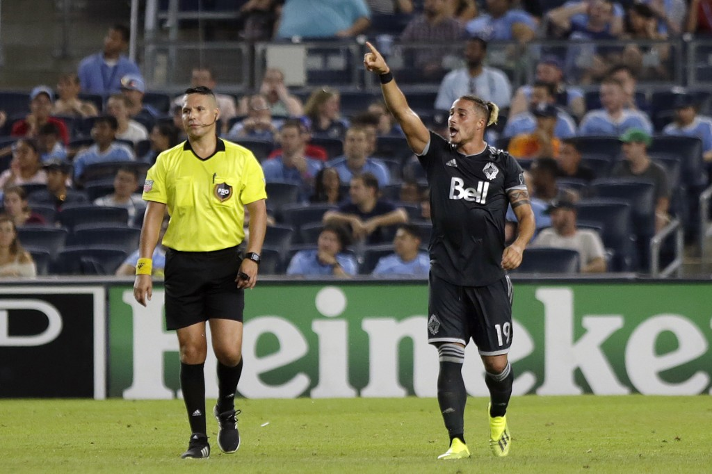 Vancouver Whitecaps' Erik Hurtado, right, celebrates his goal during the second half of an MLS soccer match against New York City FC, Saturday, Aug. 4...