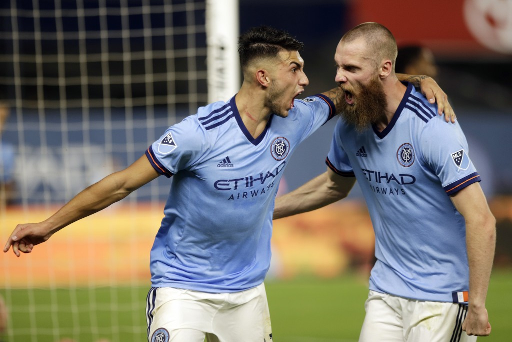 New York City FC's Valentin Castellanos, left, celebrates his goal with Jo Inge Berget, right, during the second half of an MLS soccer match against V...