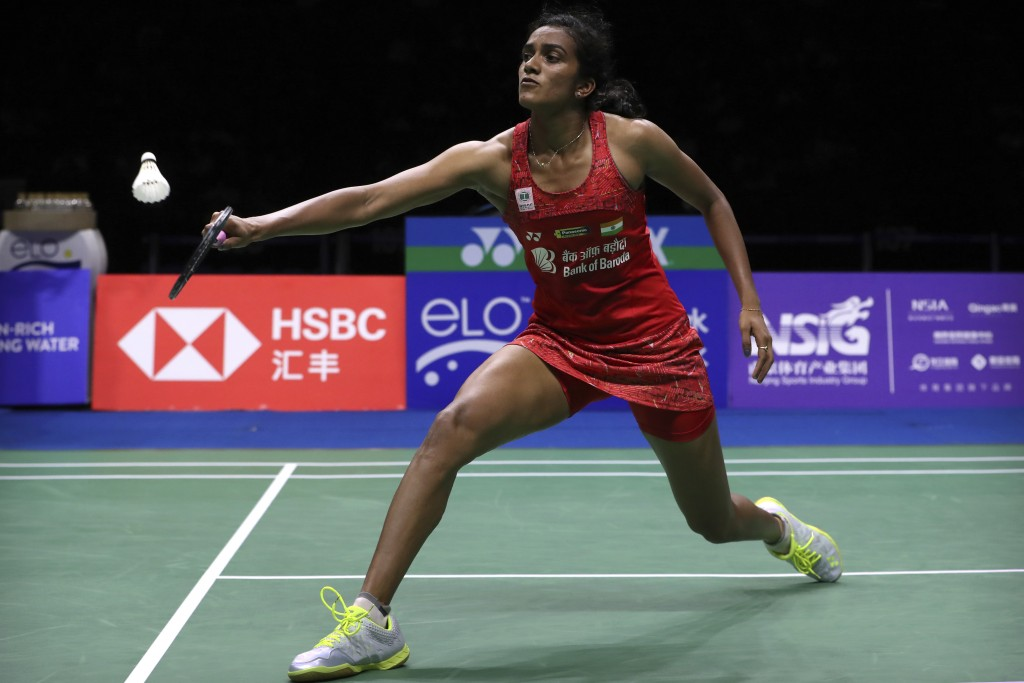 Pusarla V. Sindhu of India plays a shot while competing against Carolina Marin of Spain in their women's badminton championship match at the BWF World...
