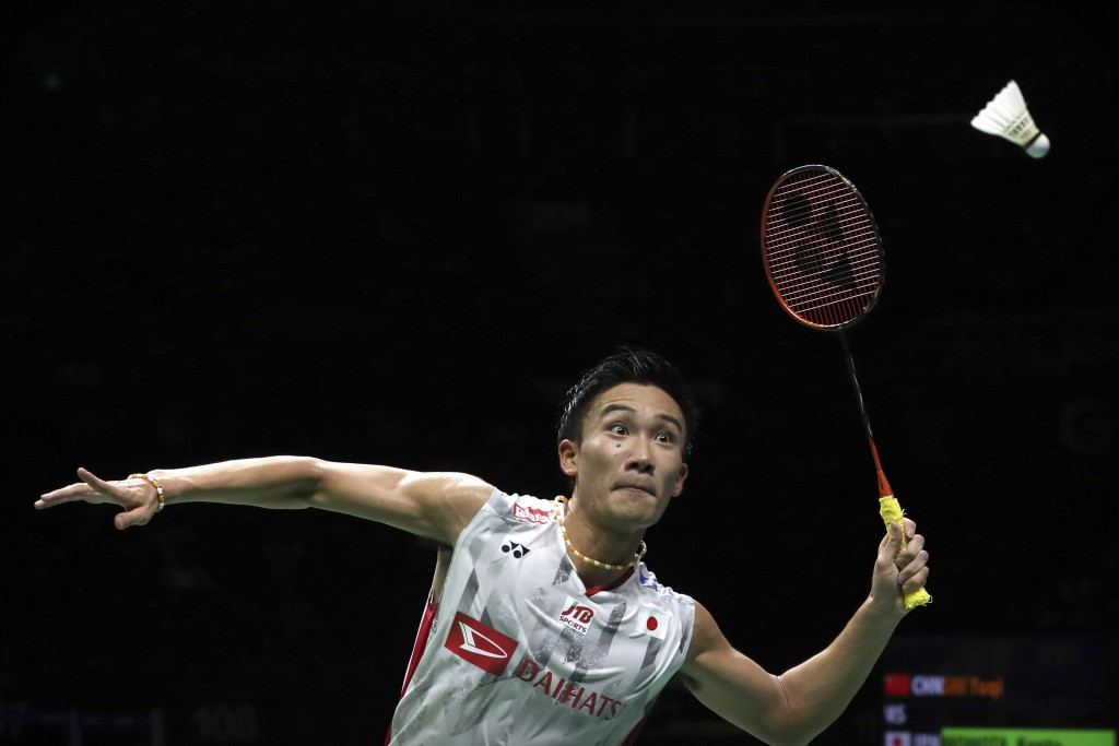 Kento Momota of Japan plays a shot while competing against Shi Yuqi of China in their men's badminton championship match at the BWF World Championship...