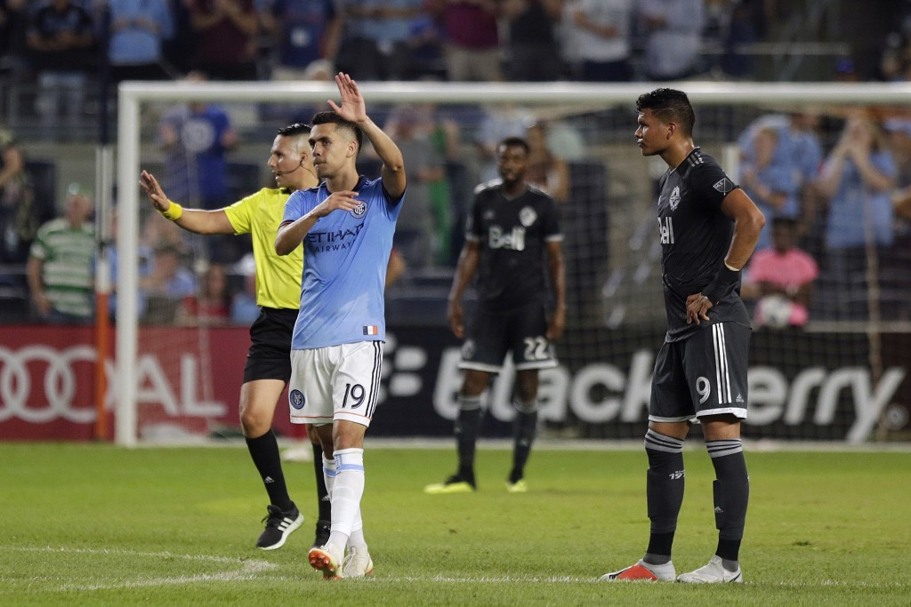 New York City FC's Jesus Medina, second left, celebrates his goal during the first half of an MLS soccer match against Vancouver Whitecaps, Saturday, ...