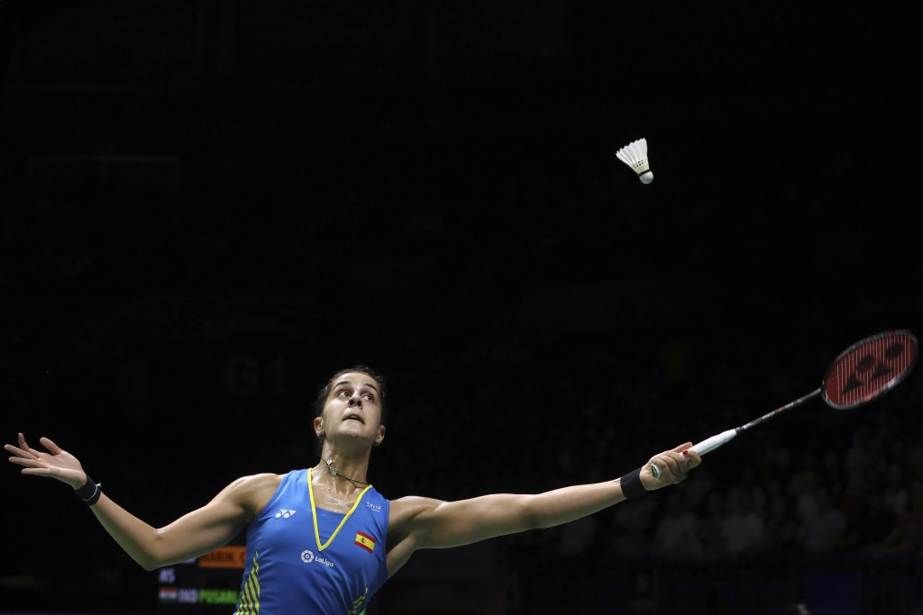 Carolina Marin of Spain plays a shot while competing against Pusarla V. Sindhu of India in their women's badminton championship match at the BWF World...