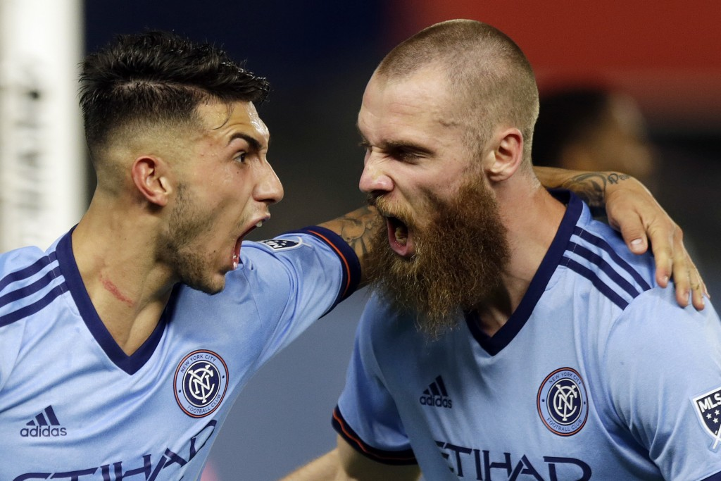 New York City FC's Valentin Castellanos, celebrates his goal with Jo Inge Berget, right, during the second half of an MLS soccer match against Vancouv...