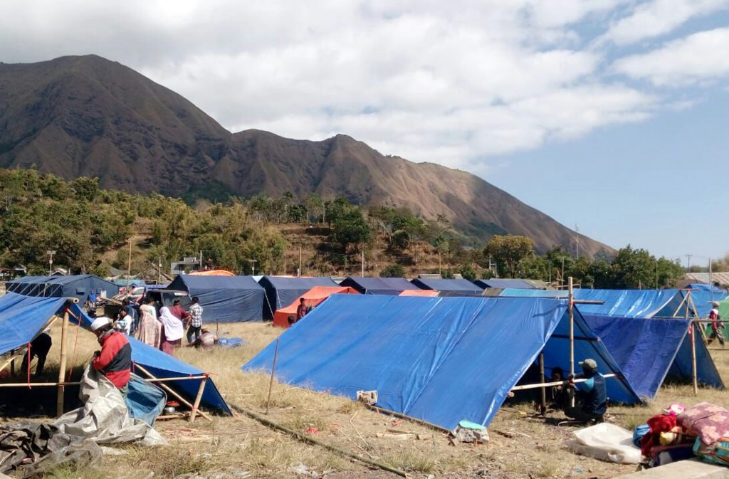 Makeshift tents are erected to be used as a temporary shelter for those affected by an earthquake in Sembalun, Lombok Island, Indonesia, Monday, Aug. ...